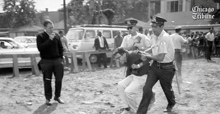 Chicago police officers carry protester Bernie Sanders, 21, in August 1963 to a police wagon from a civil rights demonstration.